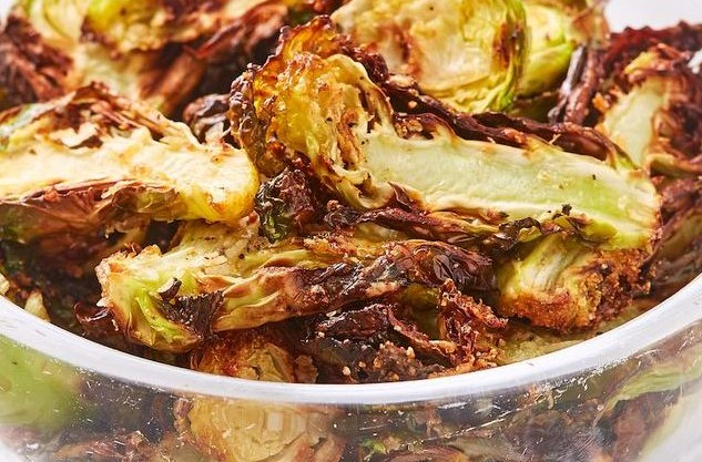 Baked brussel sprout chips in a bowl
