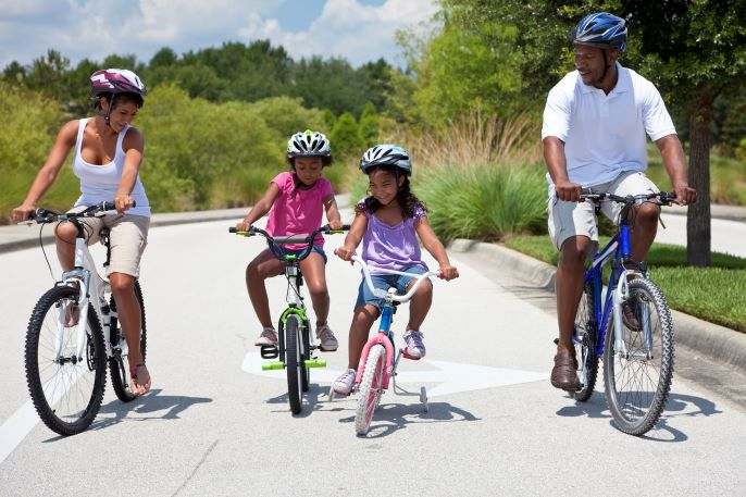 African American parents and children cycling