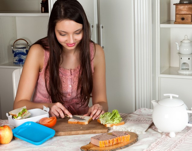 Woman making a healthy lunchbox